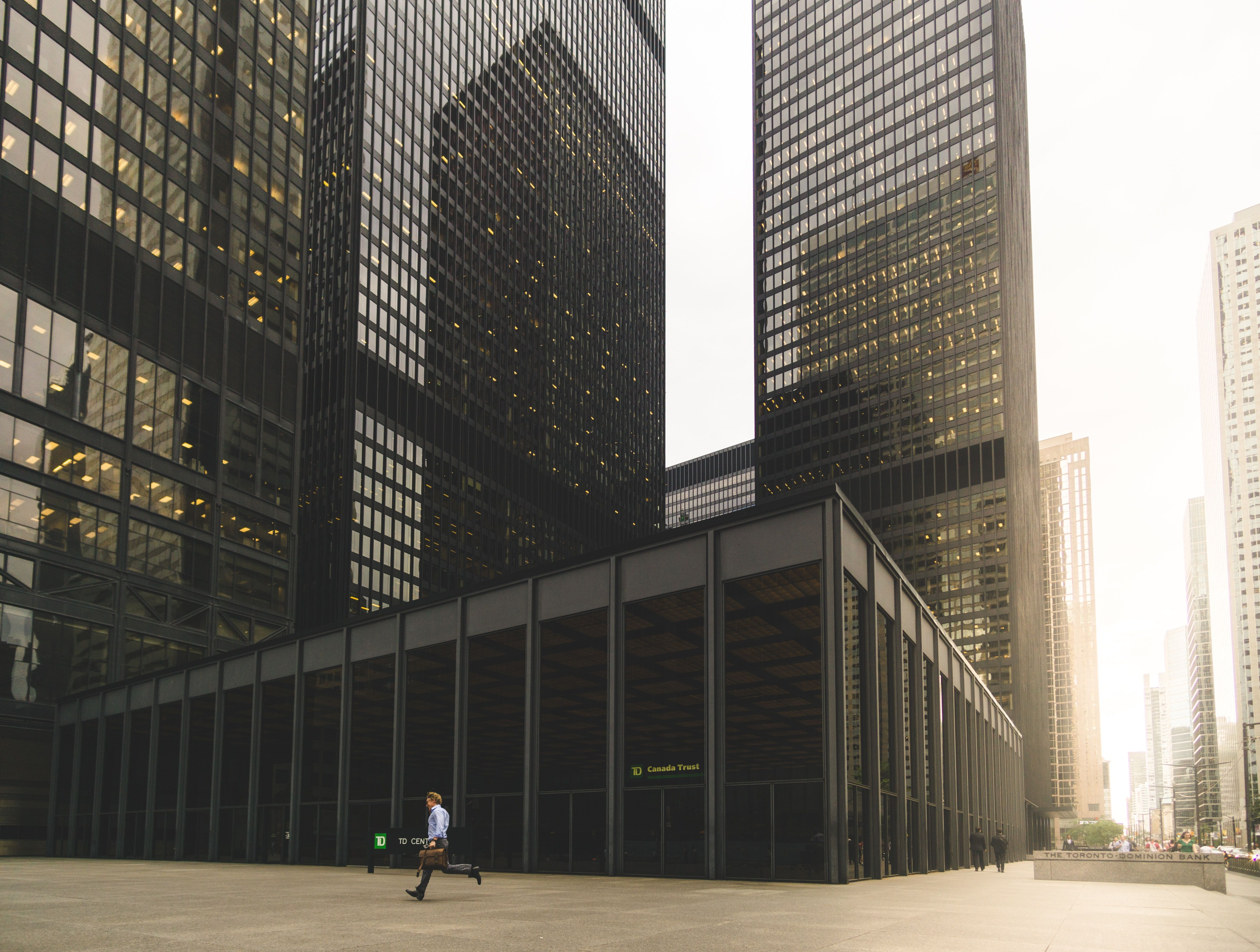 large bank building with man in shirt running