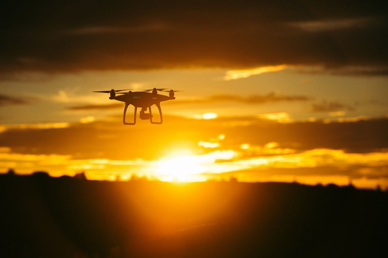 drone flying in sunset