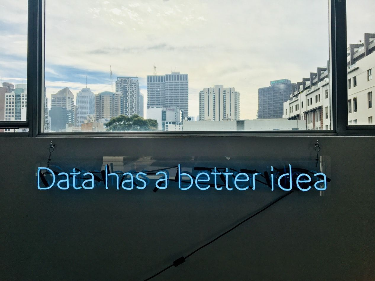 data has a better idea graphic neon sign on building