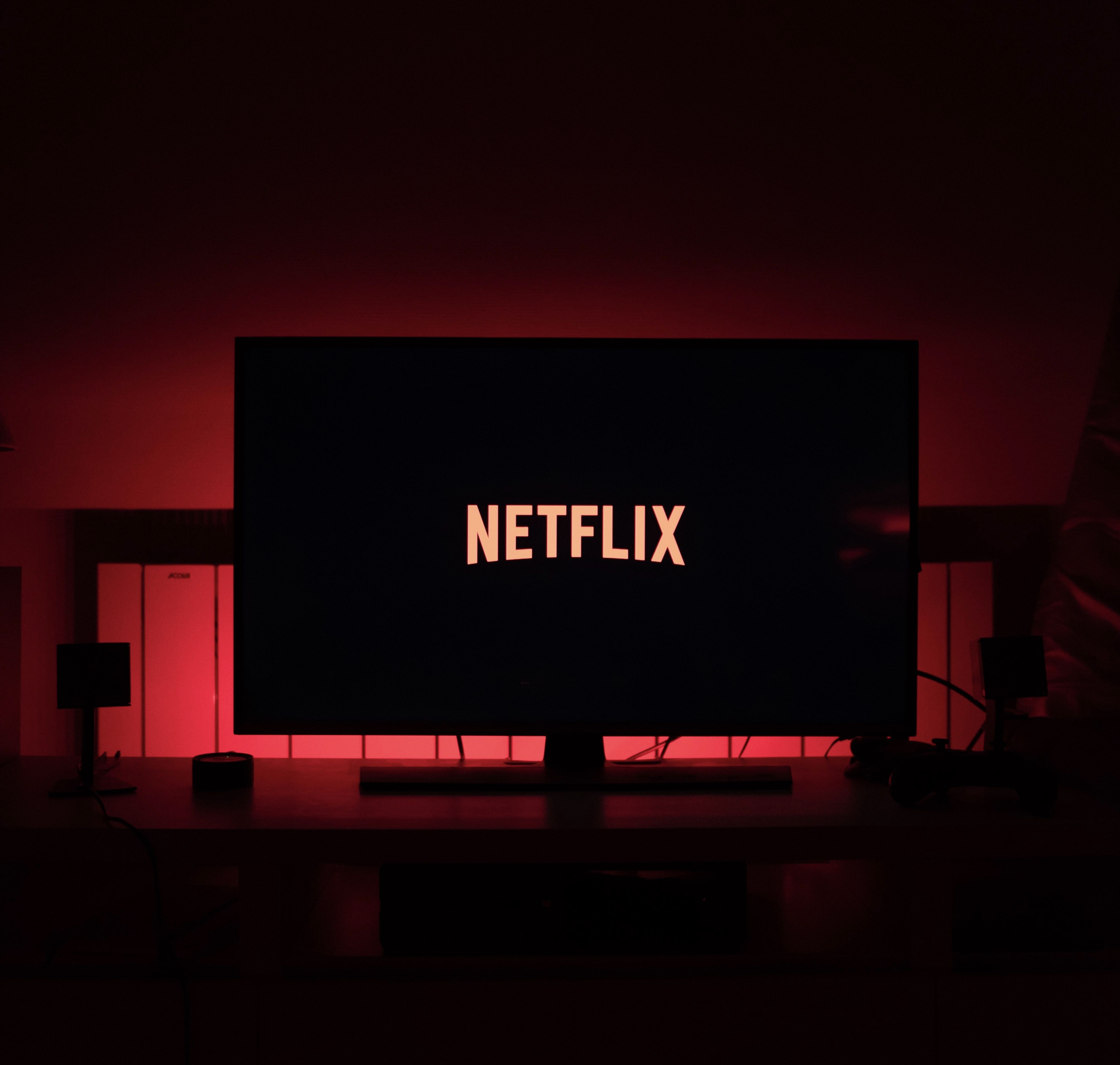 netflix logo on television streaming with dark background